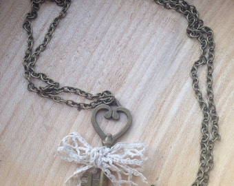 Antique style key necklace with a lace bow on matching chain