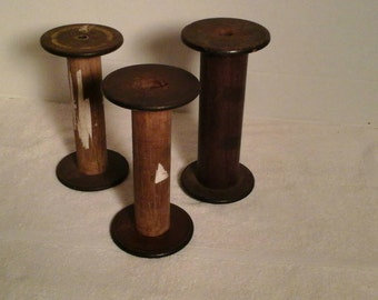 "Vintage rustic antique wood sewing thread spools, all 7"", set of 3"