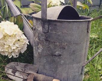 Vintage metal watering can, trowel and fork set