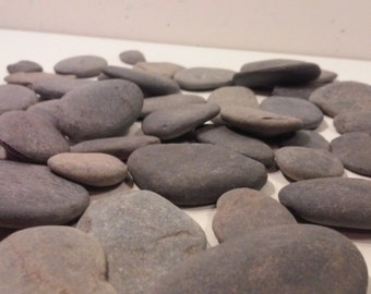 25 grey river rocks/stones/pebbles naturally shaped by the streams in the east tn mountains. Make jewelry. Art.  Wedding decor. terrariums.