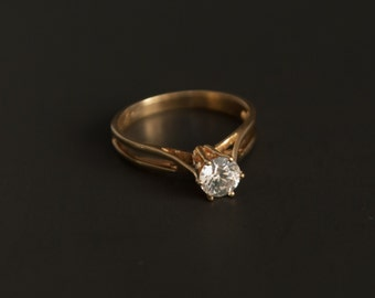 14K yellow gold solitaire with 5mm CZ in basket setting Size 6