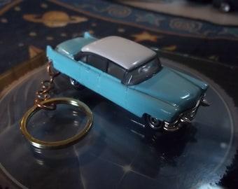 custom made 1955 cadillac fleetwood sedan,keychain,gloss sea foam blue w/gloss white top-chrome grill-bumpers and hub caps/repaint-mint