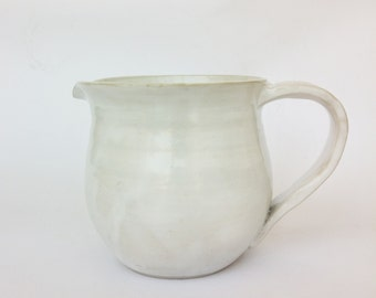 Handmade white ceramic pitcher, earthenware jug with handle