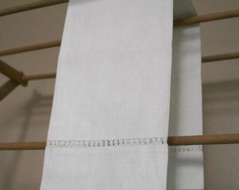 White linen tea towel in classic simple design. Beautiful simplicity.