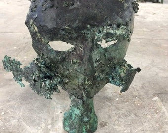 Bronze free standing masks - each one unique