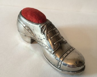 Silver cobbler's shoe pin cushion