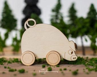 Cute little pig on wheels