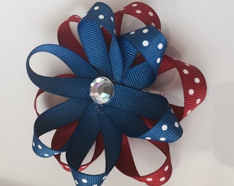 Red, white & blue flower shaped bow with clear gem