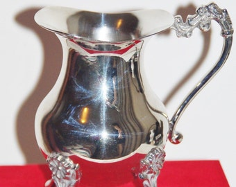 Harcourt vintage silverplate footed jug in original red velvet box