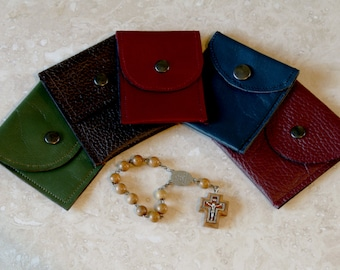 Different sizes leather pouches. Ideal as rosary cases but can also be used as coin purse or other uses.