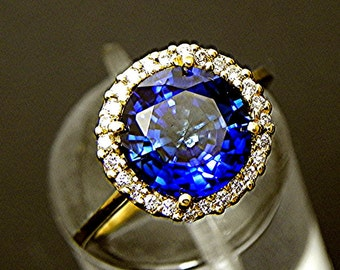 AAA  Blue Sapphire   10mm  5.00   in 14K Yellow gold Halo ring with  .35 carats of diamonds MMM