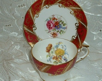 Vintage Paragon By Appointment for  Her Majesty the Queen Tea Cup and Saucer Pink  Rose White Gold Floral
