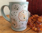 Pottry Coffee Cup: Hand Made with Orange Pops