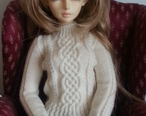 Intricate handknitted cable sweater to fit SD13 size doll