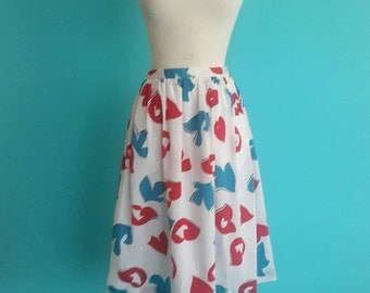 SALE 20% OFF coupon code FALLFORWARD16 ~ vintage 80's abstract bird printed skirt in red white & blue
