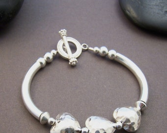 Three Sisters Bracelet - Sterling Silver Curved Tube with Hammered Hearts