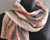 Pink and grey fashion silk scarf hand painted by an artist in salmon, black, white, grey, red, some sage green with thin gold zigzag lines