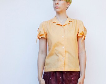 Vintage 80's Peach blouse, short sleeved button down, Ties at sleeve, lightweight, boxy fit - Medium