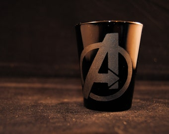 Avengers logo shot glass in black or clear glass