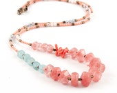 Medium-long, boho-chic, multi-gemstone necklace in pink and blue pastels. Made with cherry quartz, aquamarine, coral, glass and brass beads