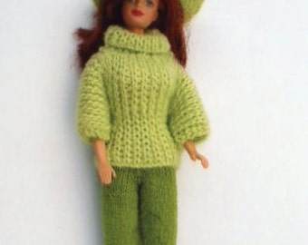 Barbie ribbed green turtleneck and wide brimmed hat and dark green pants