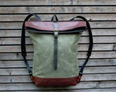 Waxed canvas backpack with leather fold to close top and vegetable tanned leather shoulderstrap and back reinforcement