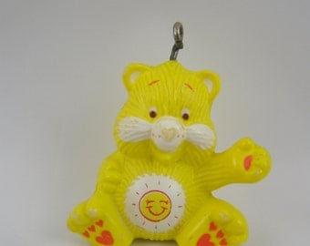 50% off clearance sale! Care Bears Funshine Bear miniature figure with hanging loop for use as pendant, charm, ornament, etc.