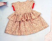 The Citrus Pop Girls Floral Cotton Dress with Double Ruffle Skirt and Puff Sleeves by Fleur + Dot