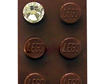 Brown LEGO (R) brick 2x4 with a Diamond color SWAROVSKI crystal on a Silver/Gold plated trace chain