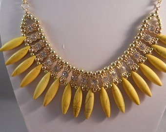 Gold Tone Bib Necklace with Yellow Turquoise Water Drop Pendants and Clear Rhinestones on a Gold Tone Chain