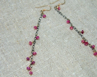 Long, dangly ruby earrings on oxidized sterling silver chain and 14kt gold filled earwires