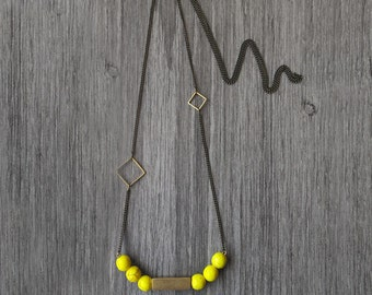 Geometric yellow brass necklace. Yellow stone beads with gold brass geometric cube. Minimal jewelry