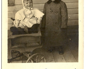 Winter,Brother and Sister in Wagon-Loraine & Robert Miller-1910s RPPC