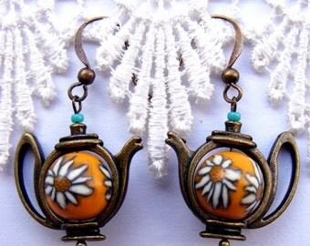 Yellow dainty daisy style teapot earrings with handmade polymer clay bead
