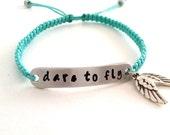 macrame bracelet with hand stamped aluminium tag and wings in aqua - hand stamped bracelet - dare to fly bracelet