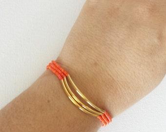 Set of 3 Coral orange and gold bracelets,stretchy orange bracelet,minimalist bracelet, seed bead bracelet, gold, noodle bracelet,bridesmaid