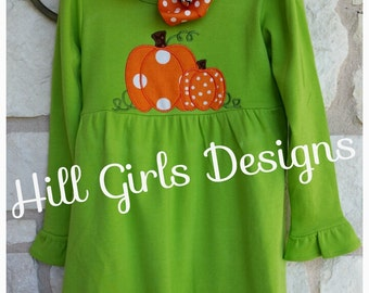 Girl's pumpkin appliquéd long sleeved ruffled dress with embroidered name