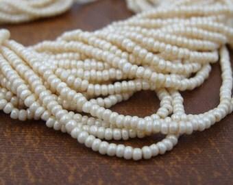 11/0 Charlotte Seed Beads Eggshell 1 Hank (6 Strands)