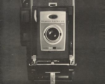 1960 Polaroid 900 Electric Eye Camera Ad Film Technology Black & White Vintage Advertising Print Wall Art Decor
