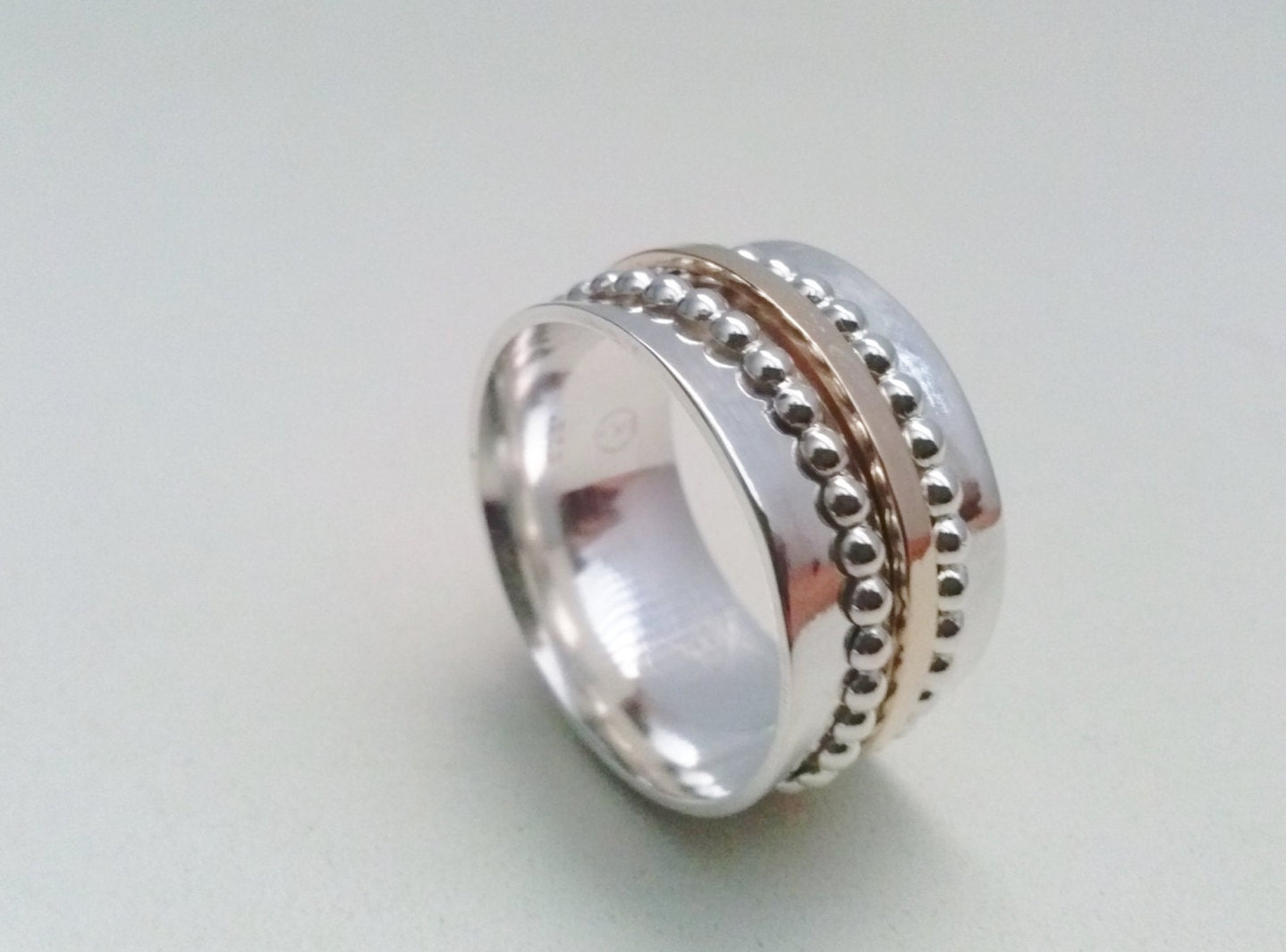 beaded spinner ring handmade with sterling silver and gold