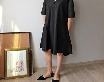v-neck dress with drop-waist design and asymmetrical hem