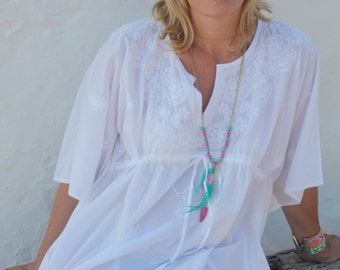 White bohemian knee lenght cotton kaftan with hand embroidery from Ibiza