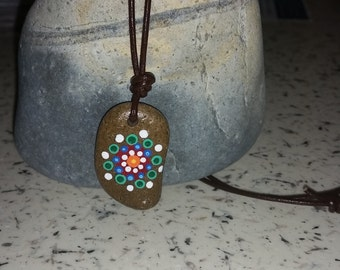 Painted beach stone pendant Mandala style