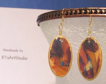 Watercolor paper earrings in blues and oranges!