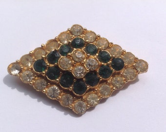 Vintage Art Deco emerald and diamond paste brooch.