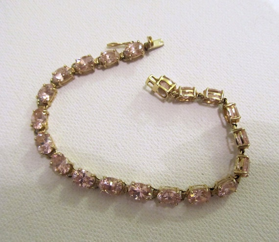 10k Yellow Gold Tennis Bracelet with 20 Soft Pink Topaz