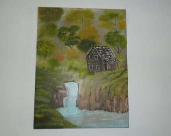 Log cabin near the waterfall