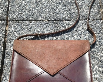 Leather bag with shoulder strap sleeve