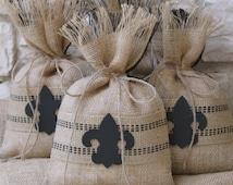 "Burlap Gift Bag or Treat Bag. Set of FOUR , Jute Webbing, Hand Painted Black, Wooden Fleur De Lis, Black and Natural, Size  7"" x 11""."