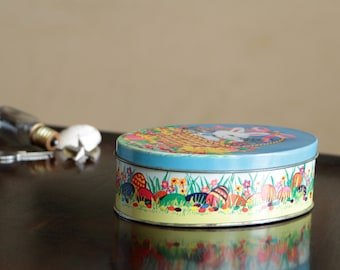 Vintage oval tin can with a lid / Container with Easter rabbits and ducks